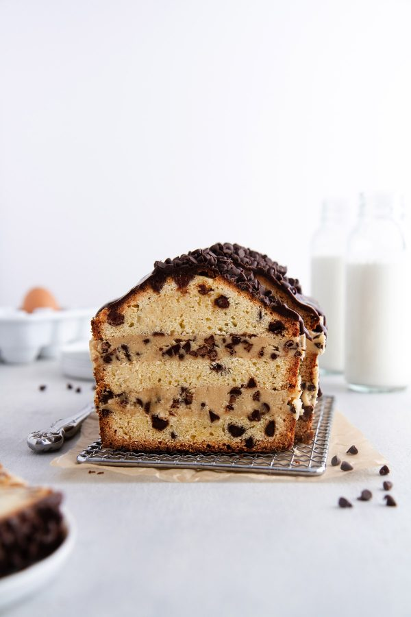 cookie dough stuffed pound cake on a cooling rack