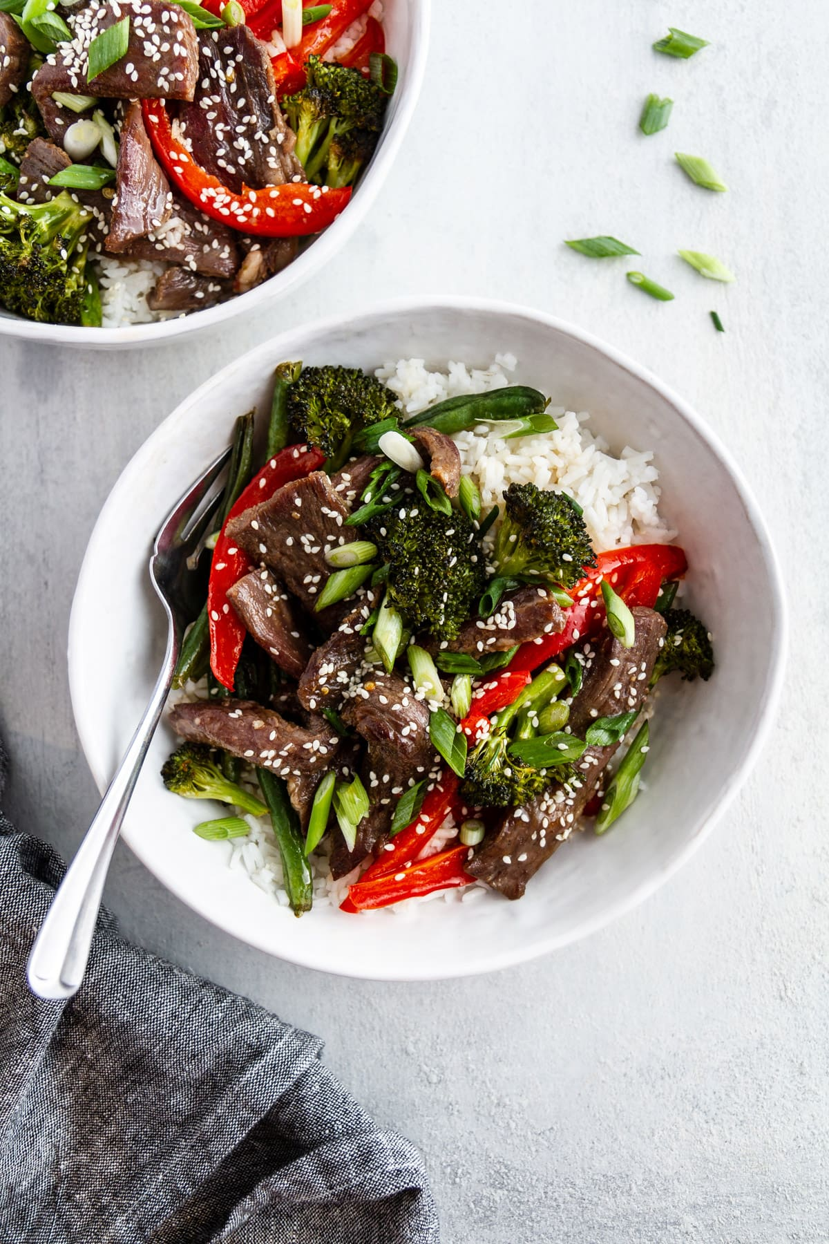 bowls of sheet pan mongolian beef on a surface