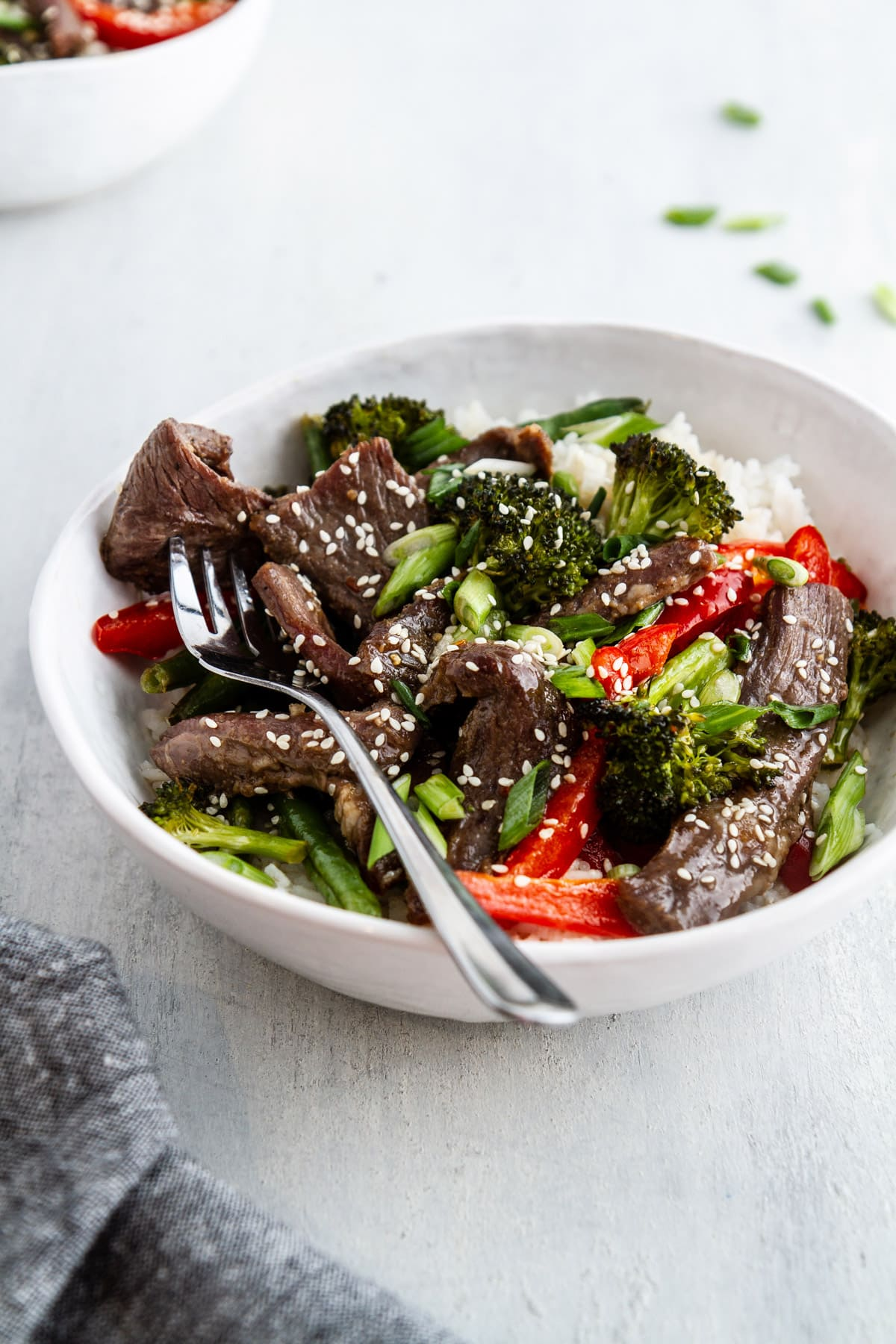a bowl of sheet pan mongolian beef on a surface