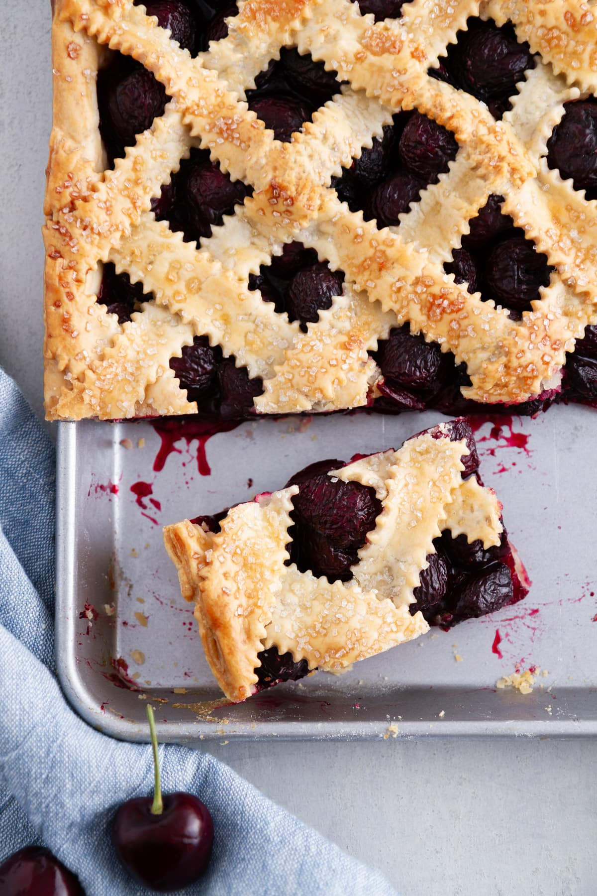 A cherry pie bar cut out on the pan