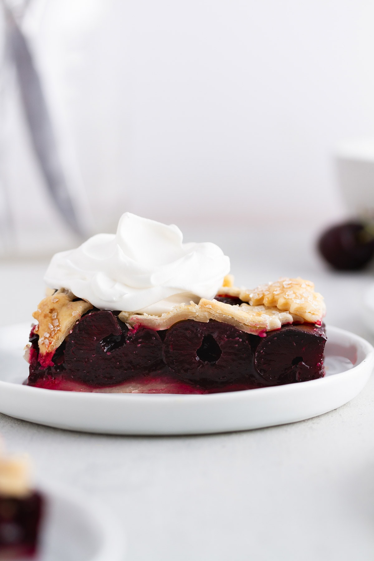 a cherry pie bar on a plate with whipped cream