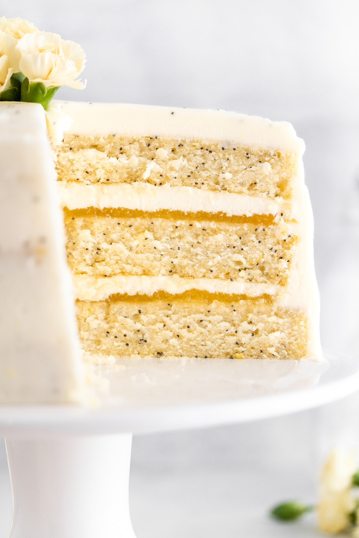 a close up shot of lemon poppy seed cake