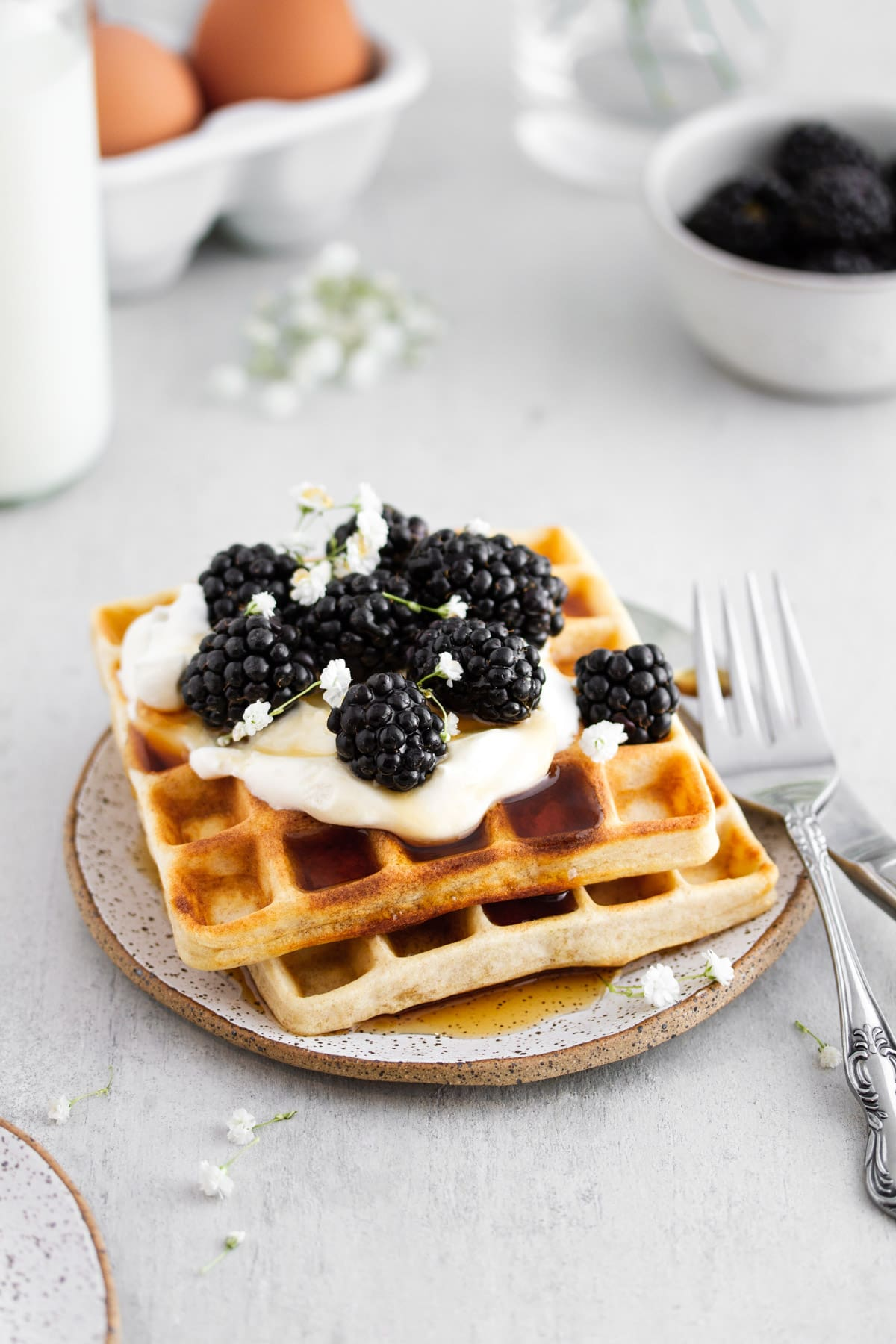 sourdough waffles with whipped cream and berries on a plate