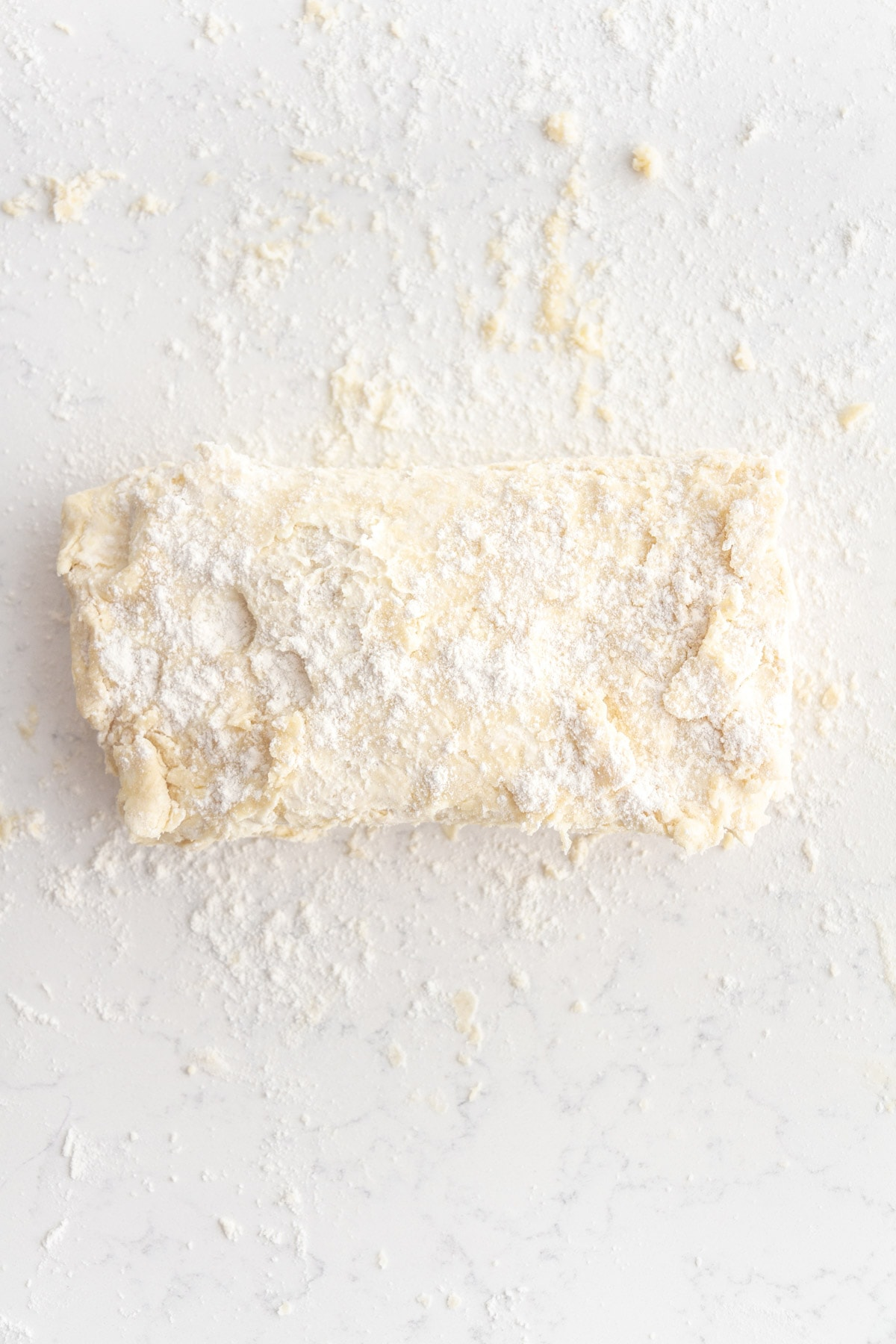rough puff pastry dough on a surface