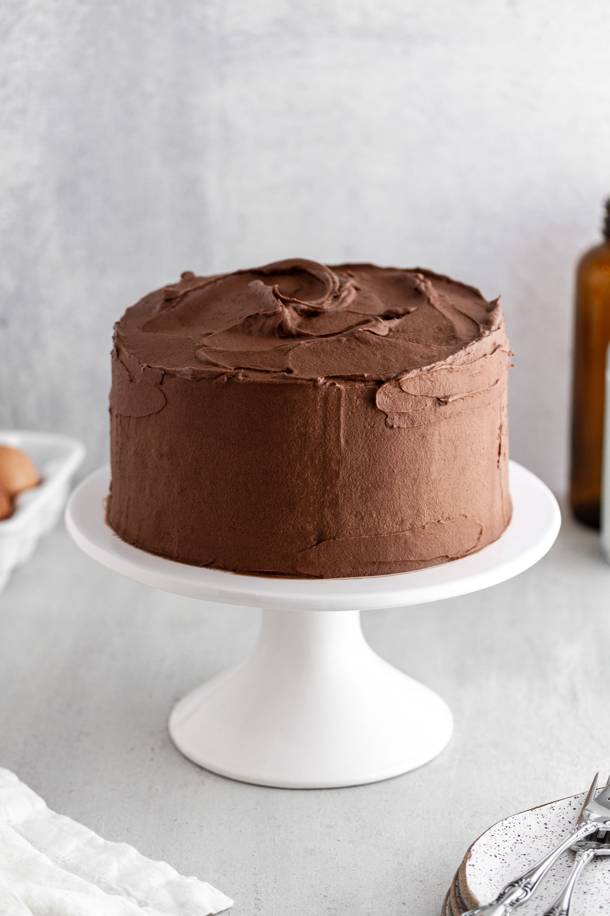 Devil's Food Cake with Chocolate Buttercream Frosting on a cake stand