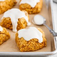 sweet potato biscuits on a baking sheet with marshmallow icing