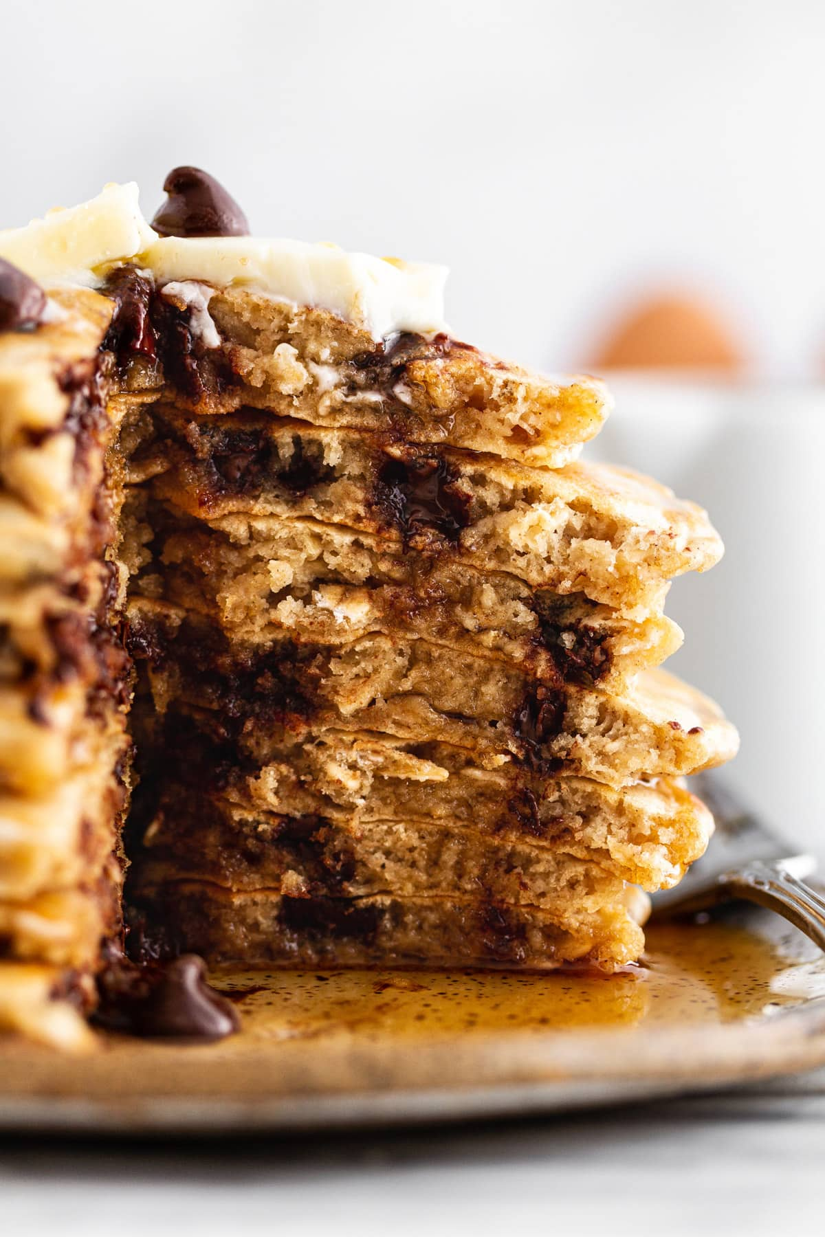 cross-section of oatmeal chocolate chip cookie pancakes on a plate