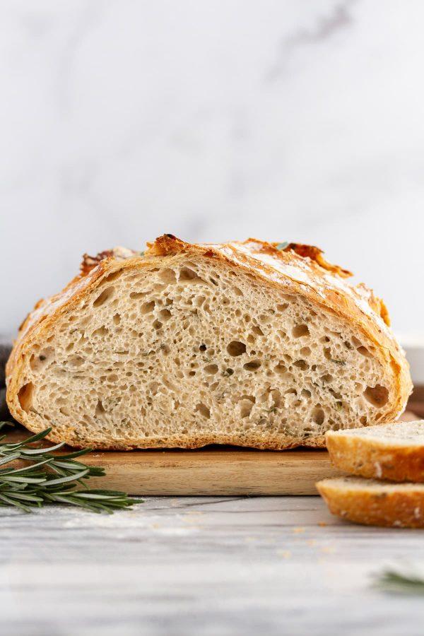 sliced rosemary-garlic no-knead bread on a cutting board