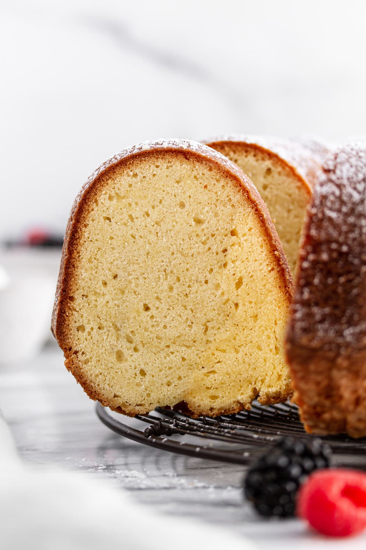 close-up shot of a slice of sour cream pound cake