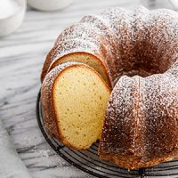 a sliced sour cream pound cake on a cooling rack