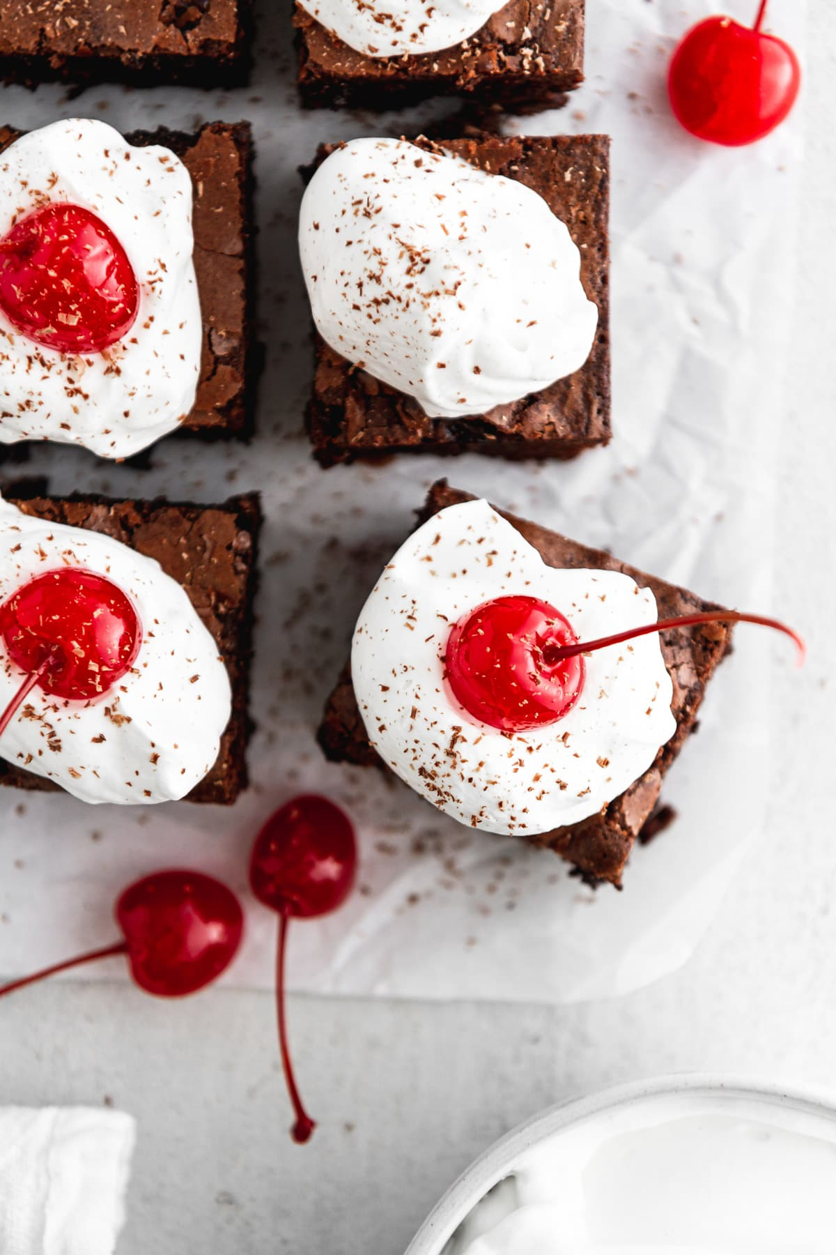 black forest cherry brownies on parchment paper