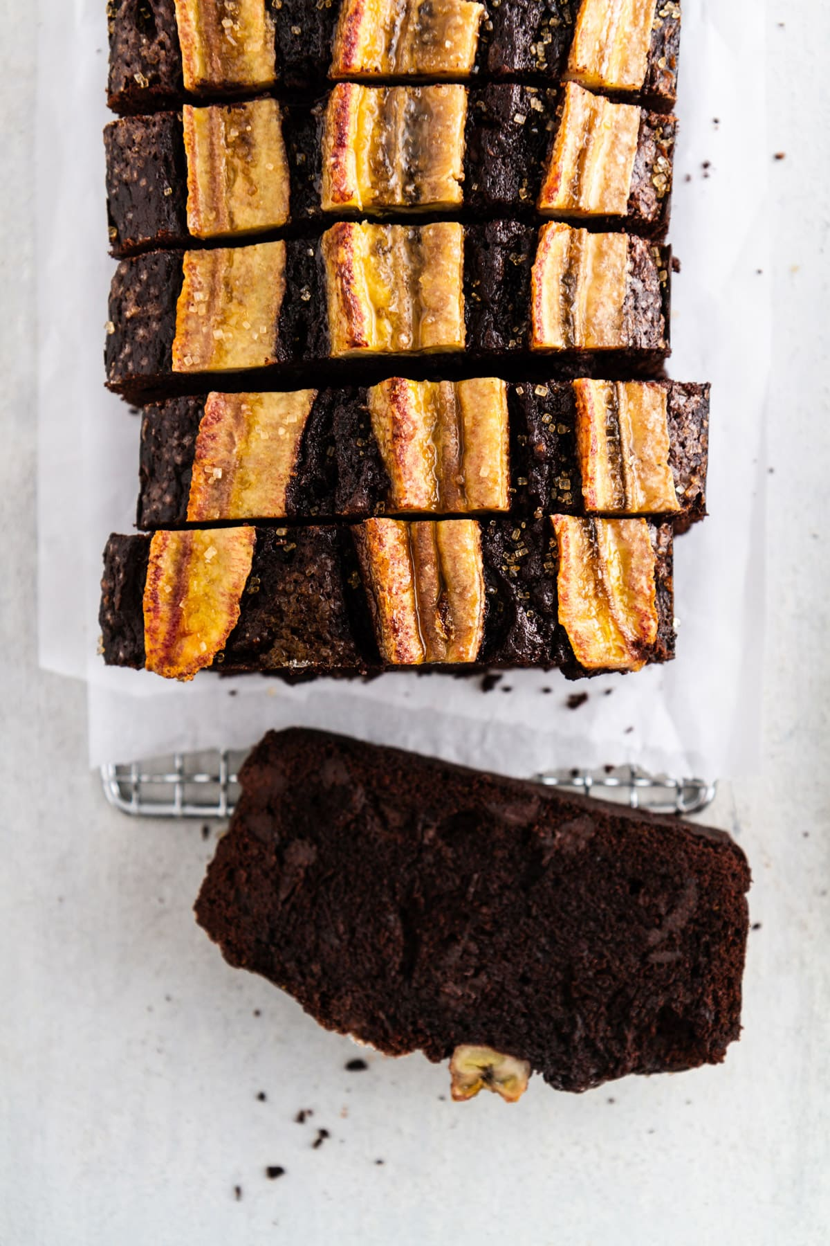 a slice of chocolate banana bread on its side