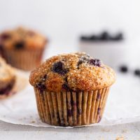 close-up of a sourdough blueberry muffin on parchment paper