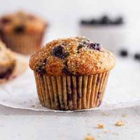 sourdough blueberry muffin on parchment paper