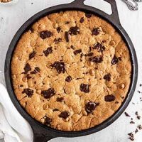 peanut butter chocolate skillet cookie on a surface