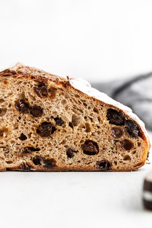 close-up of a slice of cinnamon raisin sourdough bread
