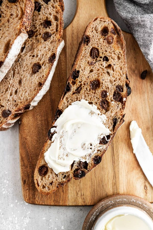 slice of cinnamon raisin sourdough bread with butter on top