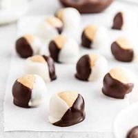 double chocolate buckeyes on parchment paper