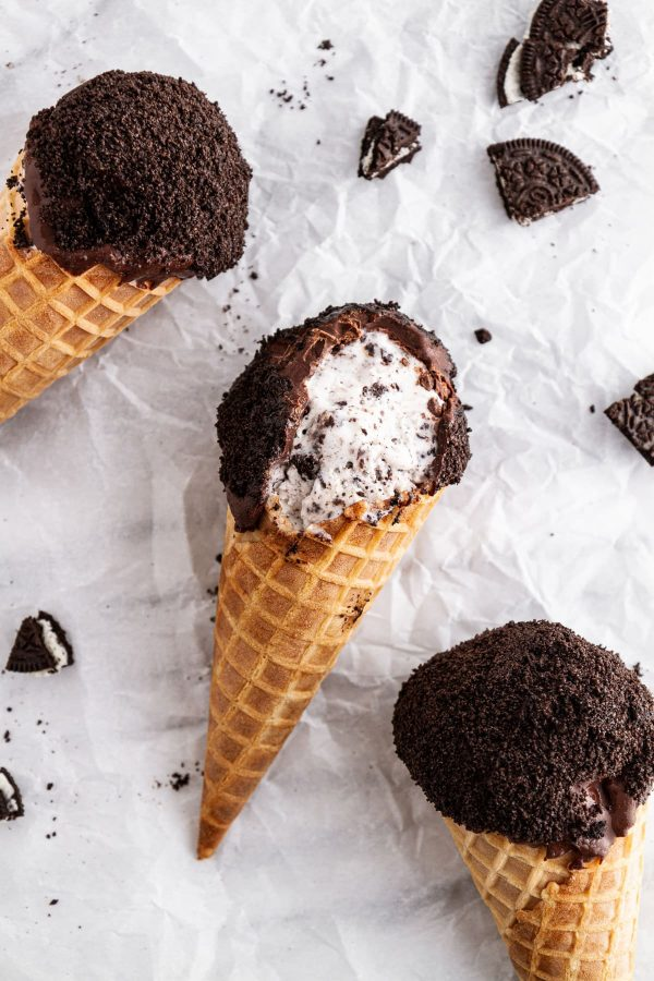 cookies and cream ice cream drumsticks on a surface
