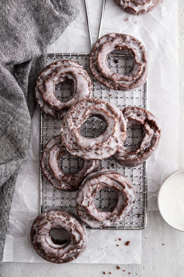 chocolate old-fashioned donuts on a cooling rack