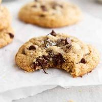 gluten free chocolate chip cookie with a bite taken out of it