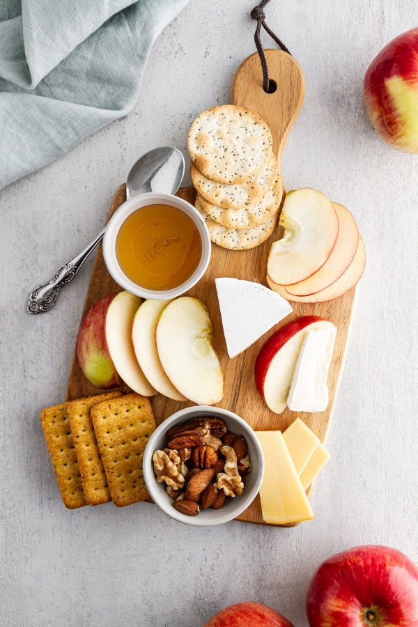 cheese board with Rave apples and various cheeses