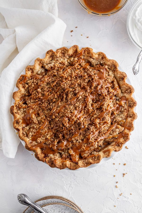 overhead shot of full Dutch caramel apple pie in pie plate