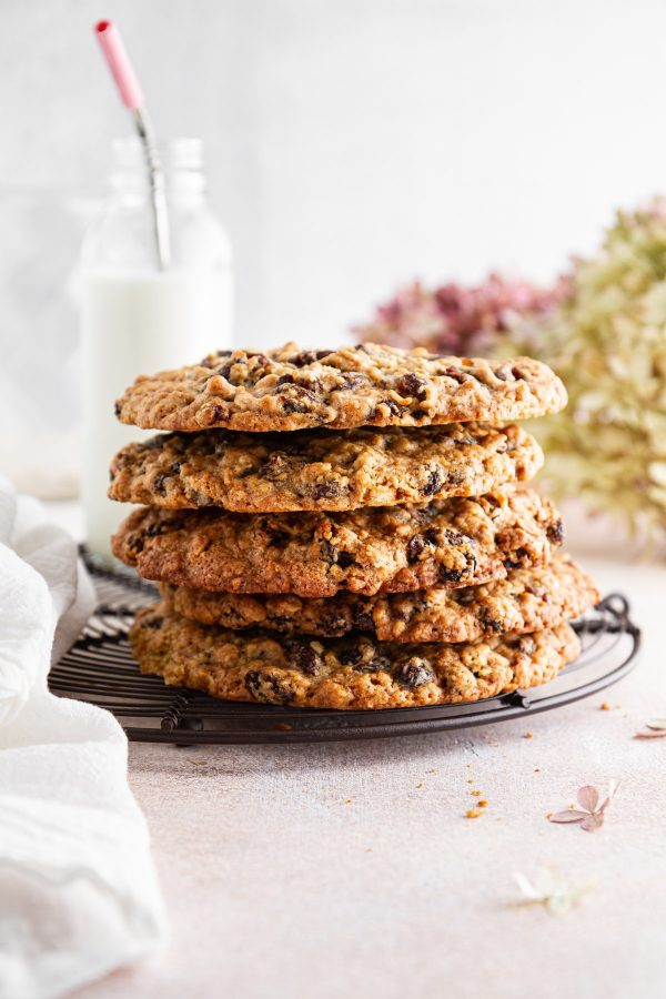 stack of giant oatmeal-raisin cookies on a cooling rack