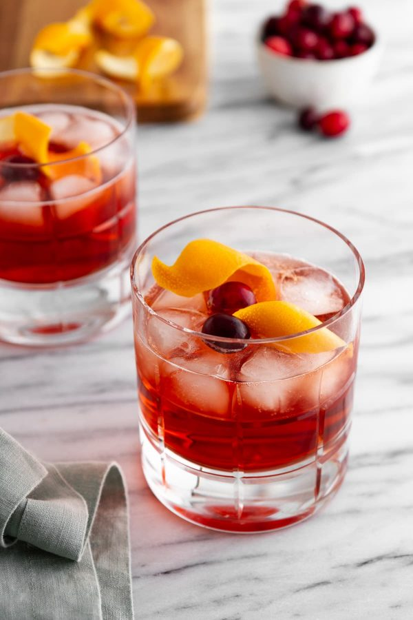 two holiday negronis in glasses on a surface