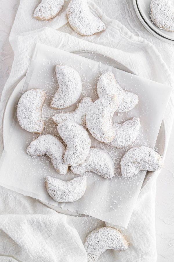 overhead image of chai-spiced crescent cookies on a plate