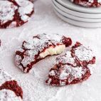 red velvet cookies on a surface covered with powdered sugar