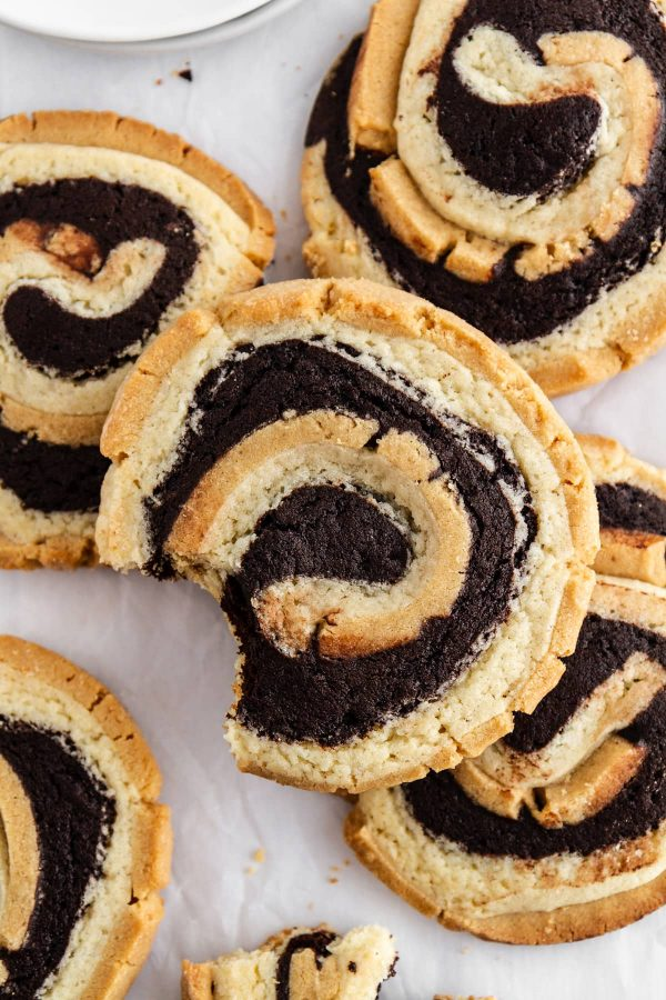 peanut butter brownie swirl cookies stacked on parchment