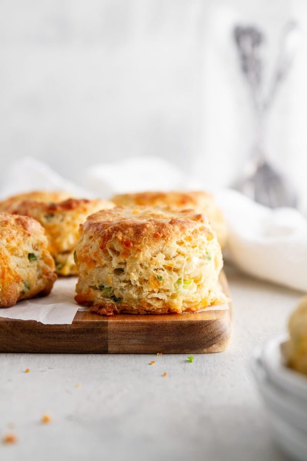 cheddar-scallion biscuits on a cutting board