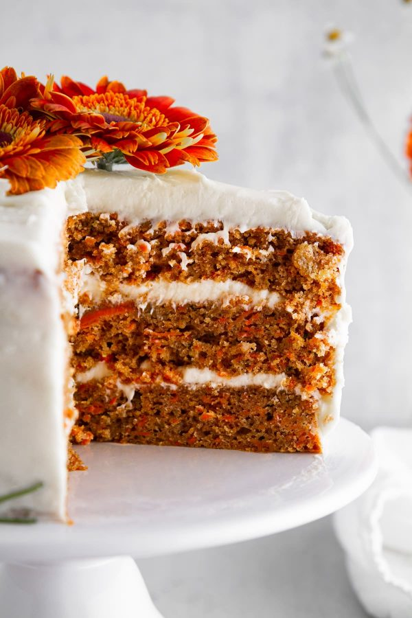close-up of a slice of carrot cake on a cake stand