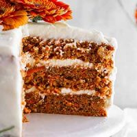 close-up of slice of carrot cake on a cake stand