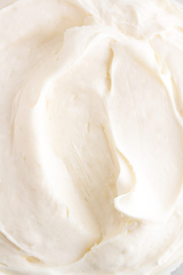 close up shot of cream cheese frosting in a bowl