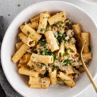 overhead image of creamy rigatoni with sausage and fennel in a bowl