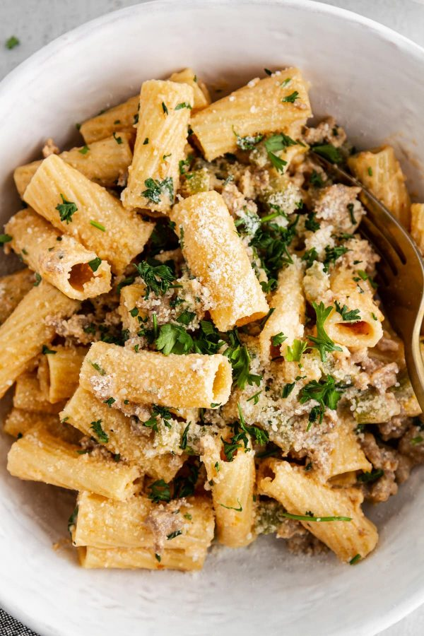 close-up image of creamy rigatoni with sausage and fennel in a bowl