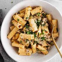 creamy rigatoni with sausage and fennel in a serving bowl
