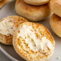 buttered English muffins on a plate
