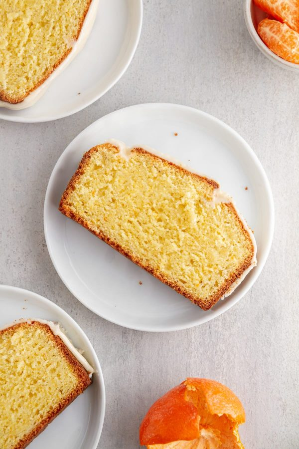 slices of iced clementine pound cake on plates