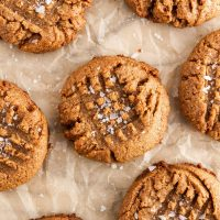 almond butter cookies on a sheet of parchment paper
