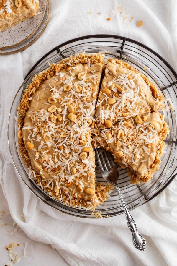 overhead shot of coconut peanut butter pie on a cooling rack