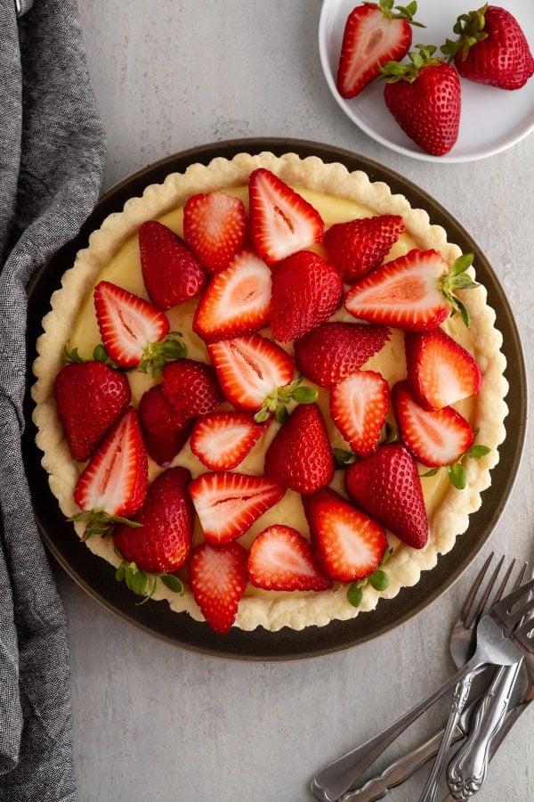 strawberry custard tart on a plate