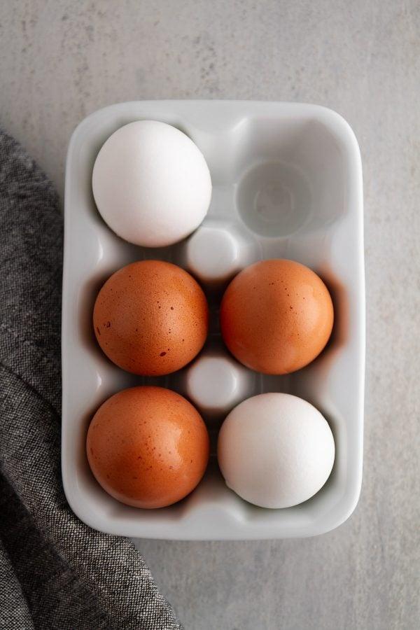 eggs in a ceramic egg crate