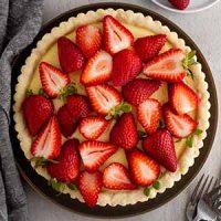strawberry custard tart on a surface