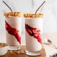 peanut butter and jelly milkshakes on a cutting board