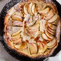 German apple pancake in a cast-iron skillet