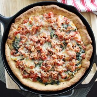 deep dish spinach + tomato pizza